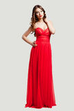 Beautiful female fashion model in red dress Royalty Free Stock Photography