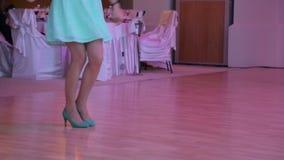 Beautiful female feet dancing on the dance floor.  stock video footage