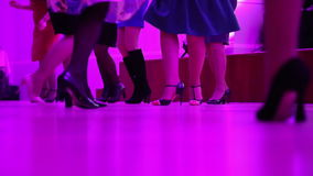 Beautiful female feet dancing on the dance floor stock video