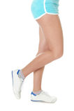 Beautiful female feet in gym shoes Stock Photography