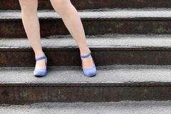 Beautiful female feet. In heel shoes on the stairs Stock Photo
