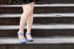 Beautiful female feet. In heel shoes on the stairs Stock Photography