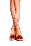 Beautiful Female Feet In Red Shoes On A White Back Royalty Free Stock Photo