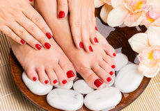 Beautiful female feet at spa salon on pedicure procedure Stock Image