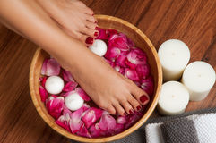Beautiful female feet at spa salon on pedicure procedure. Stock Image