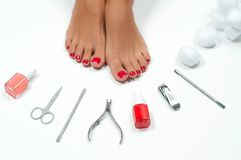 Beautiful female feet at spa salon on pedicure procedure stock photos