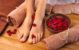 Beautiful female feet, spa salon, pedicure procedure Royalty Free Stock Photo