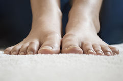 Beautiful female feet on a white towel closeup - toes and ankle. Royalty Free Stock Images