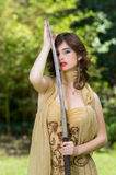 Beautiful female fighter with a sword Royalty Free Stock Photo