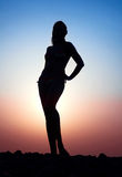 Beautiful female figure. Against the evening sun Stock Photos