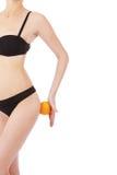 Beautiful female figure with orange Royalty Free Stock Photography