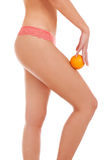 Beautiful female figure with an orange. Stock Photo