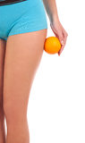 Beautiful female figure with an orange. Isolated over white background Stock Photography