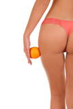 Beautiful female figure with an orange. Royalty Free Stock Images