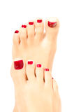 Beautiful female foot with red pedicure Stock Photography