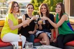 Beautiful female friends drinking Stock Images