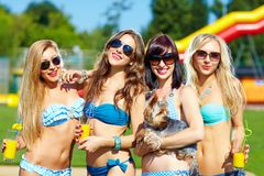 Beautiful female friends having fun on summer vacation Stock Image