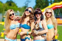 Beautiful female friends having fun on summer vacation Stock Image