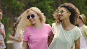 Beautiful female friends hugging and dancing, sharing selfie in social network. Stock footage stock video