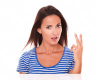 Beautiful female gesturing a victory sign Stock Image
