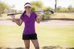 Beautiful female golf player Stock Image