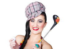 Beautiful female golfer holding golf ball and club Royalty Free Stock Photography