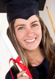 Beautiful female graduate Stock Images