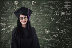 Beautiful female graduate smiling in class Royalty Free Stock Photography