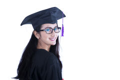 Beautiful female graduate smiling on white Stock Images