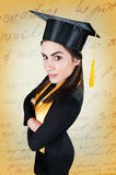 Beautiful female graduate wearing a graduation gown Stock Images
