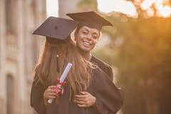 Happy young alumni royalty free stock photo