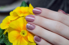 Beautiful female hand with beige nail design Royalty Free Stock Images