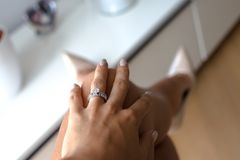 Beautiful female hand with elegant diamond ring royalty free stock photography