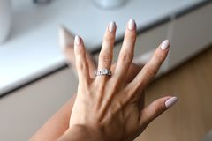 Beautiful female hand with elegant diamond ring. Closeup photo of beautiful female hand with elegant diamond ring. Holidays and celebrations concept Stock Photo