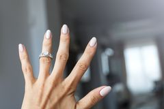 Beautiful female hand with elegant diamond ring. Stock Photo