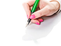 Beautiful female hand holding fountain pen Royalty Free Stock Photography