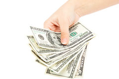 Beautiful female hand holding a stack of banknotes. Stock Photography