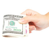 Beautiful female hand holding a stack of banknotes. Royalty Free Stock Image