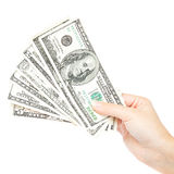 Beautiful female hand holding a stack of banknotes. Royalty Free Stock Photography