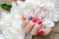 Beautiful female hand with red nail design stock photography