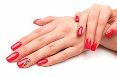 Beautiful female hand with red nails isolated on white Royalty Free Stock Images