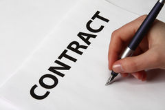 Beautiful female hand signing a contract Royalty Free Stock Image