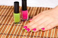 Beautiful female hand with two-color manicure Royalty Free Stock Photo