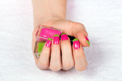 Beautiful female hand with two-color manicure Stock Photos