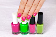 Beautiful female hand with two-color manicure Stock Image