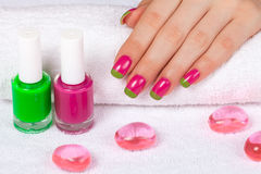 Beautiful female hand with two-color manicure Stock Images