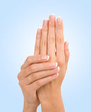 Beautiful female hands on blue Royalty Free Stock Images