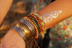 Beautiful female hands with bracelets Stock Images