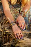 Beautiful female hands with bracelets Royalty Free Stock Images