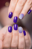Beautiful female hands with bright manicure. Nails covered with nail Stock Photos
